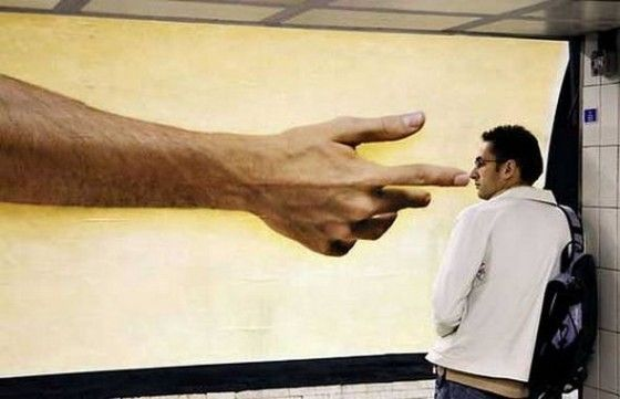 Hand on a poster picking a bystanders nose