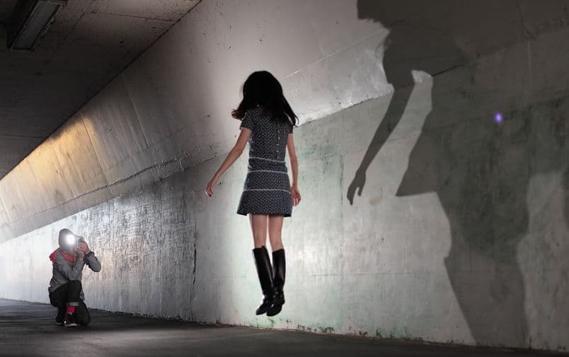 pretty japanese girl floats in tunnel