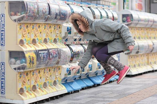 pretty japanese girl floats at vending machine