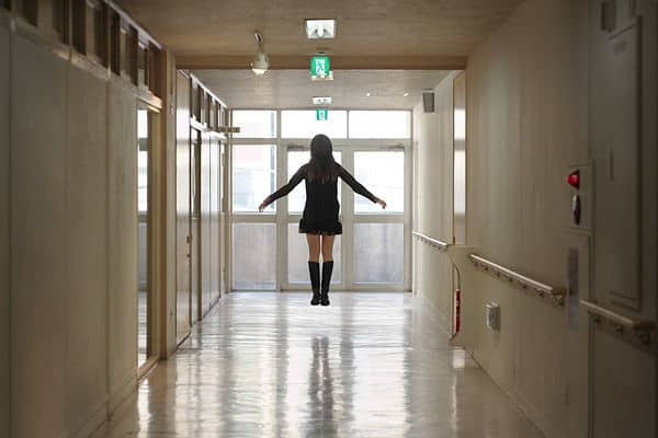 pretty japanese girl floats in hallway