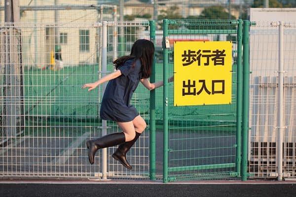 pretty japanese girl floats through gate