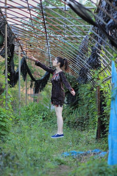pretty japanese girl floats in abandoned structure