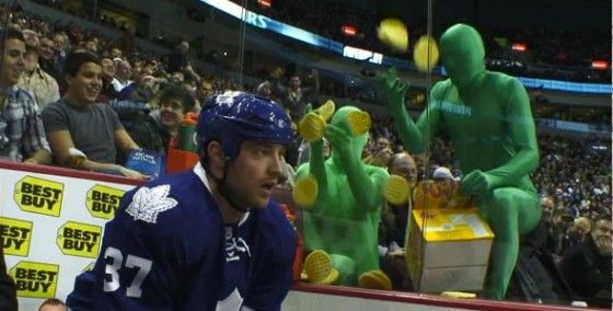 Green Men at Vancouver Canucks game taunt opposing NHL players