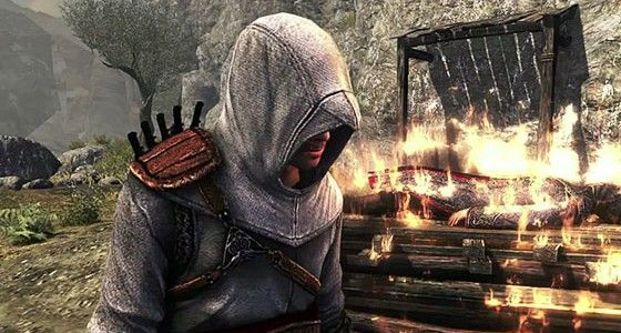 Altair near burning man in Assassin's Creed Revelations