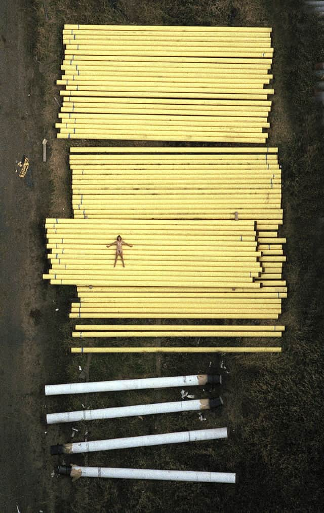 john crawford aerial nudes naked woman on pile of pvc pipes