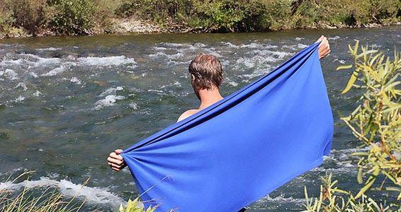 person-using-microfiber-towel